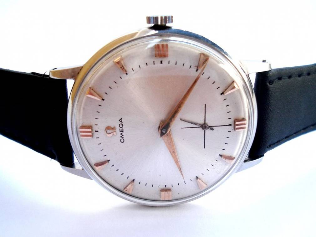 how to identify a fake omega watch